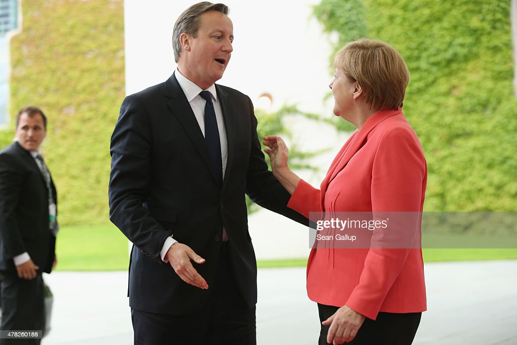 German Chancellor Angela Merkel greets British Prime Minister David Cameron upon his arrival for talks at the Chancellery on June 24, 2015 in Berlin, Germany. The two leaders are meeting as creditors, European Union officials and members of the Greek government scramble to find a solution to avoid a Greek state bankruptcy and departure by Greece from the Eurozone.