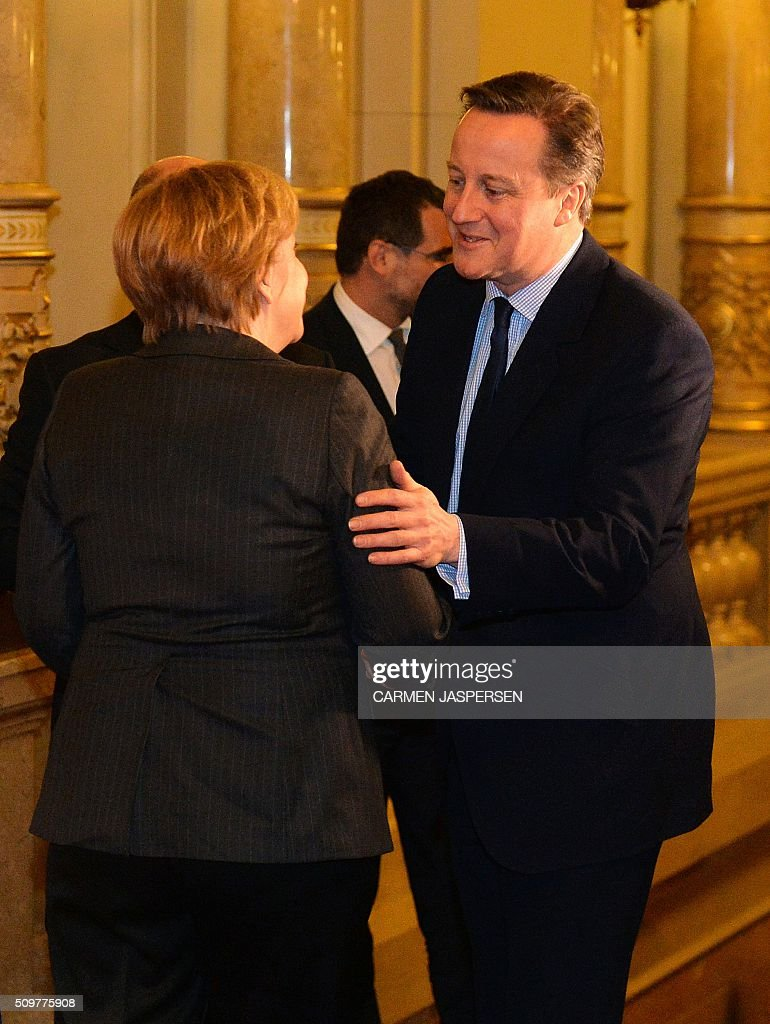 German Chancellor Angela Merkel (L) greets British Prime Minister David Cameron ahead of the Matthiae-Mahl Dinner attended in Hamburg, northern Germany on February 12, 2016. / AFP / CARMEN JASPERSEN