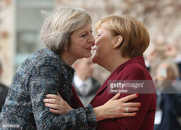 German Chancellor Angela Merkel greets British Prime Minister Theresa May upon her arrival for talks between US President Barack Obama and western...