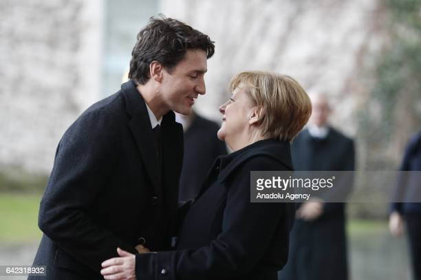 German Chancellor Angela Merkel greets Canadian Prime Minister Justin Trudeau during official welcoming ceremony ahead of their meeting at the German...