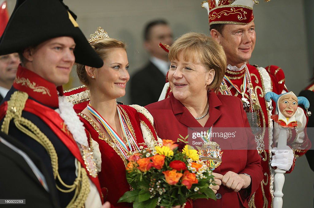 German Chancellor <a gi-track='captionPersonalityLinkClicked' href=/galleries/search?phrase=Angela+Merkel&family=editorial&specificpeople=202161 ng-click='$event.stopPropagation()'>Angela Merkel</a> greets Carnival delegates from all over Germany in an annual ceremony at the Chancellery on January 29, 2013 in Berlin, Germany. Germany is in the midst of Carnival season, which ends with its highpoint between Rose Monday and Ash Wednesday in a tradition common in several countries in Europe and the Americas.