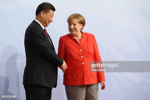 German Chancellor Angela Merkel greets Chinese President Xi Jinping upon his arrival for the first day of the G20 economic summit on July 7 2017 in...