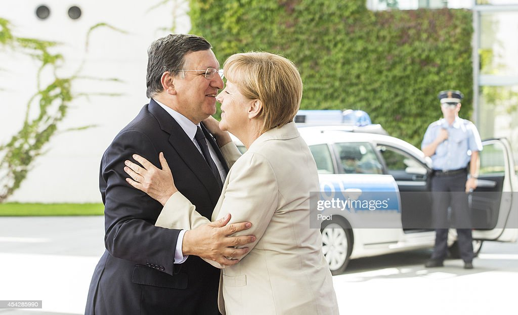 German Chancellor Angela Merkel greets European Commission President Jose Manuel Barroso upon his arrival for the German government Balkan conference at the Chancellery on August 28, 2014 in Berlin, Germany. The leaders of Albania, Kosovo, Croatia, Bosnia-Herzegovina, Slovenia, Serbia, Montenegro and Macedonia are participating in the conference that also includes Austrian Chancellor Werner Faymann and European Commission President Jose Manuel Barroso.