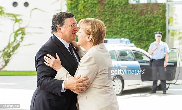 German Chancellor Angela Merkel greets European Commission President Jose Manuel Barroso upon his arrival for the German government Balkan conference...