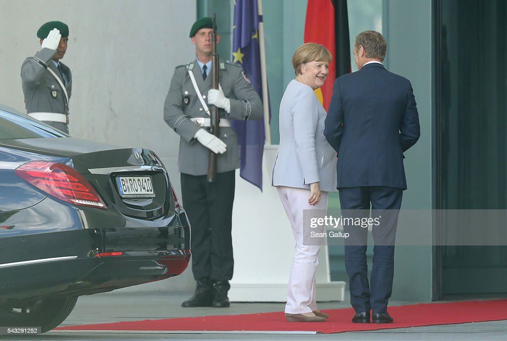 German Chancellor <a gi-track='captionPersonalityLinkClicked' href=/galleries/search?phrase=Angela+Merkel&family=editorial&specificpeople=202161 ng-click='$event.stopPropagation()'>Angela Merkel</a> greets European Council President <a gi-track='captionPersonalityLinkClicked' href=/galleries/search?phrase=Donald+Tusk&family=editorial&specificpeople=870281 ng-click='$event.stopPropagation()'>Donald Tusk</a> upon his arrival four days after the Brexit vote was confirmed in the United Kingdom at the Chancellery on June 27, 2016 in Berlin, Germany. Merkel is scheduled to receive French President Francois Hollande, Italian Prime Minister Matteo Renzi and European Council President <a gi-track='captionPersonalityLinkClicked' href=/galleries/search?phrase=Donald+Tusk&family=editorial&specificpeople=870281 ng-click='$event.stopPropagation()'>Donald Tusk</a> today to discuss the consequences of last week's Brexit vote.