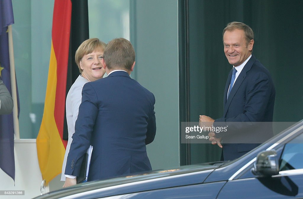 German Chancellor <a gi-track='captionPersonalityLinkClicked' href=/galleries/search?phrase=Angela+Merkel&family=editorial&specificpeople=202161 ng-click='$event.stopPropagation()'>Angela Merkel</a> greets European Council President <a gi-track='captionPersonalityLinkClicked' href=/galleries/search?phrase=Donald+Tusk&family=editorial&specificpeople=870281 ng-click='$event.stopPropagation()'>Donald Tusk</a> (R) and a member of his delegation upon his arrival four days after the Brexit vote was confirmed in the United Kingdom at the Chancellery on June 27, 2016 in Berlin, Germany. Merkel is scheduled to receive French President Francois Hollande, Italian Prime Minister Matteo Renzi and European Council President <a gi-track='captionPersonalityLinkClicked' href=/galleries/search?phrase=Donald+Tusk&family=editorial&specificpeople=870281 ng-click='$event.stopPropagation()'>Donald Tusk</a> today to discuss the consequences of last week's Brexit vote.