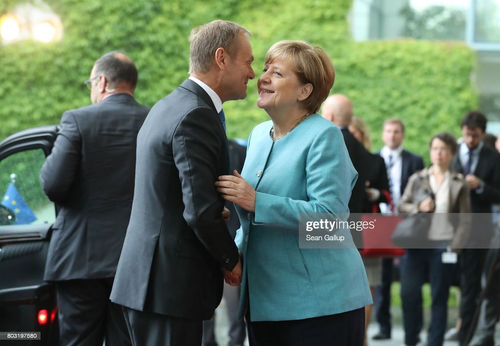 German Chancellor Angela Merkel (R) greets European Council President Donald Tusk upon his arrival for a meeting of European Union leaders at the Chancellery on June 29, 2017 in Berlin, Germany. The leaders are meeting head of the upcoming G20 summit in Hamburg.