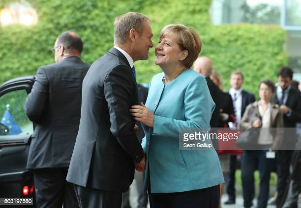 German Chancellor Angela Merkel greets European Council President Donald Tusk upon his arrival for a meeting of European Union leaders at the...