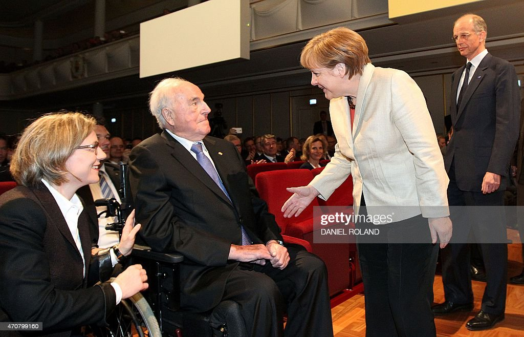 German chancellor <a gi-track='captionPersonalityLinkClicked' href=/galleries/search?phrase=Angela+Merkel&family=editorial&specificpeople=202161 ng-click='$event.stopPropagation()'>Angela Merkel</a> (2nd) greets former chancellor <a gi-track='captionPersonalityLinkClicked' href=/galleries/search?phrase=Helmut+Kohl&family=editorial&specificpeople=202518 ng-click='$event.stopPropagation()'>Helmut Kohl</a> (2ndL) sitting on his wheelchair and his wife <a gi-track='captionPersonalityLinkClicked' href=/galleries/search?phrase=Maike+Kohl-Richter&family=editorial&specificpeople=5847197 ng-click='$event.stopPropagation()'>Maike Kohl-Richter</a> (L) and BASF CEO <a gi-track='captionPersonalityLinkClicked' href=/galleries/search?phrase=Kurt+Bock&family=editorial&specificpeople=2540103 ng-click='$event.stopPropagation()'>Kurt Bock</a> (R) before the start of an event to celebrate the 150th anniversary of German chemicals company BASF at its headquarter in Ludwigshafen am Rhein, western Germany, on April 23, 2015. ROLAND
