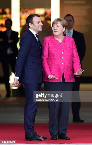 German Chancellor Angela Merkel greets French President Emmanuel Macron prior talks on May 15 2017 at the chancellery in Berlin one day after the new...