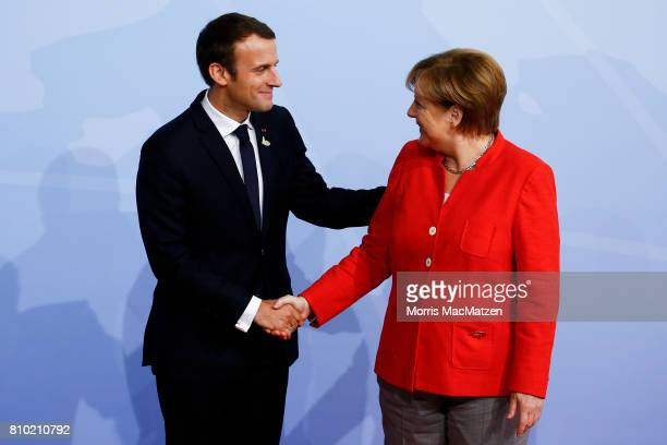 German Chancellor Angela Merkel greets French President Emmanuel Macron upon his arrival for the first day of the G20 economic summit on July 7 2017...