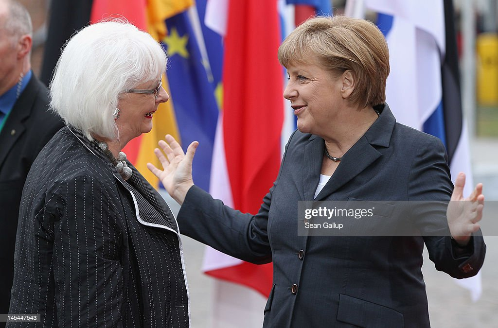 German Chancellor <a gi-track='captionPersonalityLinkClicked' href=/galleries/search?phrase=Angela+Merkel&family=editorial&specificpeople=202161 ng-click='$event.stopPropagation()'>Angela Merkel</a> (R) greets Icelandic Prime Minister <a gi-track='captionPersonalityLinkClicked' href=/galleries/search?phrase=Johanna+Sigurdardottir&family=editorial&specificpeople=5692033 ng-click='$event.stopPropagation()'>Johanna Sigurdardottir</a> upon at the 2012 Council of Baltic Sea States Summit on May 30, 2012 in Stralsund, Germany. Leaders of the eleven member states as well as representatives of the European Union are meeting to discuss matters related to energy, the environment and economic development during the two-day summit.
