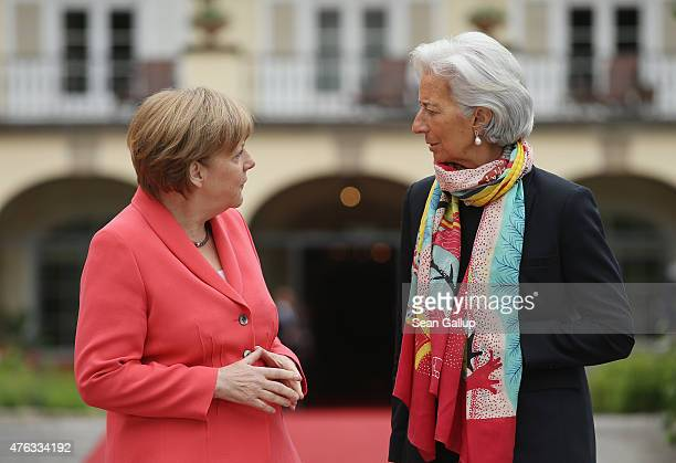 German Chancellor Angela Merkel greets International Monetary Fund Managing Director Christine Lagarde on the second day of the summit of G7 nations...