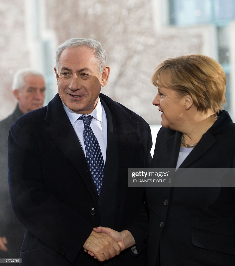 German Chancellor Angela Merkel (R) greets Israeli Prime Minister Benjamin Netanyahu as he arrives at the Chancellery in Berlin, on December 6, 2012 before taking part in a joint meeting of the cabinets of both countries amid diplomatic tensions over settlement building and Berlin's abstention in the UN's recent Palestine vote.