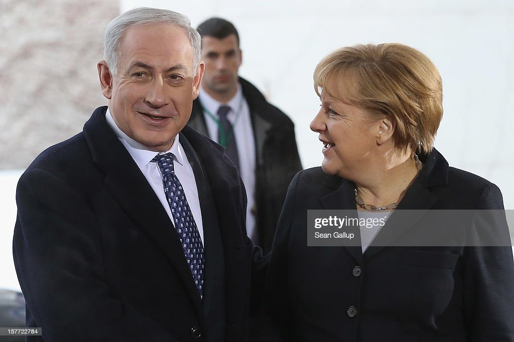 German Chancellor <a gi-track='captionPersonalityLinkClicked' href=/galleries/search?phrase=Angela+Merkel&family=editorial&specificpeople=202161 ng-click='$event.stopPropagation()'>Angela Merkel</a> greets Israeli Prime Minister Benjamin Netanyahu upon his arrival at the Chancellery on December 6, 2012 in Berlin, Germany. The German and Israeli governments are meeting today in Berlin for German-Israeli government consultations.