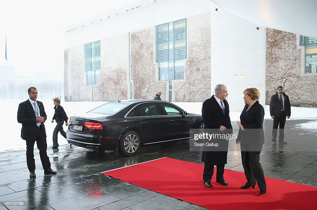 German Chancellor <a gi-track='captionPersonalityLinkClicked' href=/galleries/search?phrase=Angela+Merkel&family=editorial&specificpeople=202161 ng-click='$event.stopPropagation()'>Angela Merkel</a> (R) greets Israeli Prime Minister <a gi-track='captionPersonalityLinkClicked' href=/galleries/search?phrase=Benjamin+Netanyahu&family=editorial&specificpeople=118594 ng-click='$event.stopPropagation()'>Benjamin Netanyahu</a> upon his arrival at the Chancellery on December 6, 2012 in Berlin, Germany. The German and Israeli governments are meeting today in Berlin for German-Israeli government consultations.