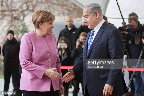 German Chancellor Angela Merkel greets Israeli Prime Minister Benjamin Netanyahu upon his arrival at the Chancellery for the 6th GermanIsraeli...