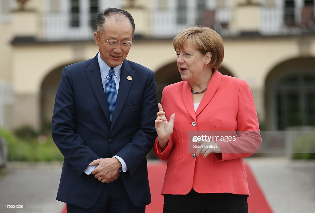 German Chancellor Angela Merkel greets President of the World Bank Group Jim Yong Kim on the second day of the summit of G7 nations at Schloss Elmau...