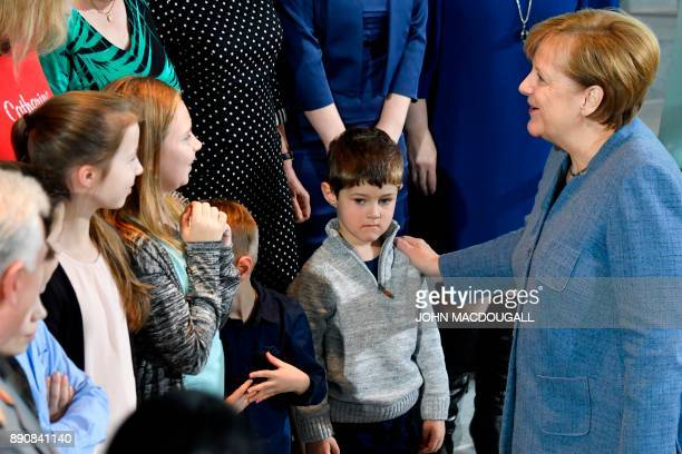 German Chancellor Angela Merkel greets relatives and children of German Bundeswehr soldiers serving abroad on December 12 2017 at the Chancellery in...