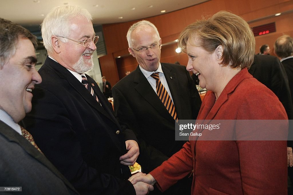 German Chancellor <a gi-track='captionPersonalityLinkClicked' href=/galleries/search?phrase=Angela+Merkel&family=editorial&specificpeople=202161 ng-click='$event.stopPropagation()'>Angela Merkel</a> greets (from L to R) Saarland State Governor Peter Mueller, Schleswig-Holstein State Governor Peter Harry Carstensen and North Rhine Westfalia State Governor Juergen Ruettgers at the Chancellery on December 13, 2006 in Berlin, Germany. State governors from across Germany are meeting in Berlin to discuss, among other issues, a national ban on smoking in restaurants, bars, hospitals and schools. Recent legislation failed after lawmakers could not decide whether the ban is a federal or state-level issue.