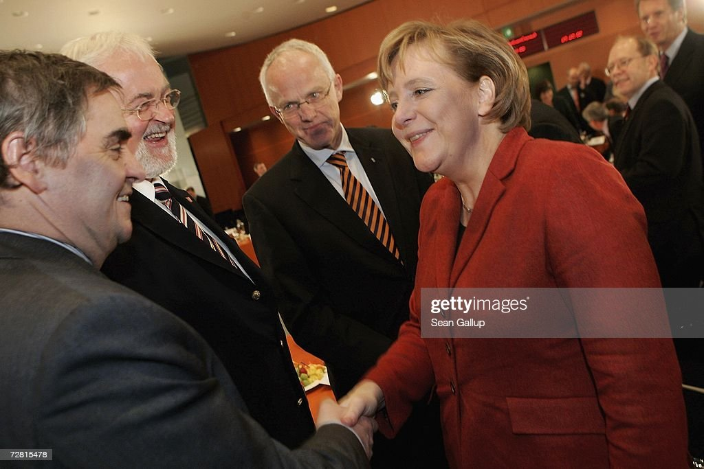 German Chancellor <a gi-track='captionPersonalityLinkClicked' href=/galleries/search?phrase=Angela+Merkel&family=editorial&specificpeople=202161 ng-click='$event.stopPropagation()'>Angela Merkel</a> (R) greets (from L-R) Saarland State Governor Peter Mueller, Schleswig-Holstein State Governor Peter Harry Carstensen and North Rhine Westfalia State Governor Juergen Ruettgers at the Chancellery on December 13, 2006 in Berlin, Germany. State governors from across Germany are meeting in Berlin to discuss, among other issues, a national ban on smoking in restaurants, bars, hospitals and schools. Recent legislation failed after lawmakers could not decide whether the ban is a federal or state-level issue.