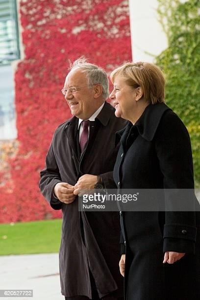 German Chancellor Angela Merkel greets Swiss President Johann SchneiderAmmann upon his arrival at the Chancellery in Berlin on November 2 2016
