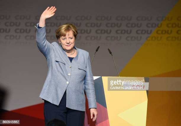 German Chancellor Angela Merkel greets the audience during the last campaign meeting of the leader of her Christian Democratic Union party in Lower...
