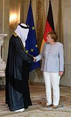 German Chancellor Angela Merkel greets the Unired Arab Emirates ambassador Ali Abdulla Mohamed Saeed Al Ahmed during foreign diplomatic...