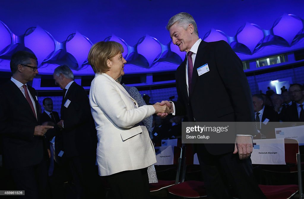 German Chancellor Angela Merkel greets ThyssenKrupp Chairman Heinrich Hiesinger at the annual congress of the German Federation of Industry on...