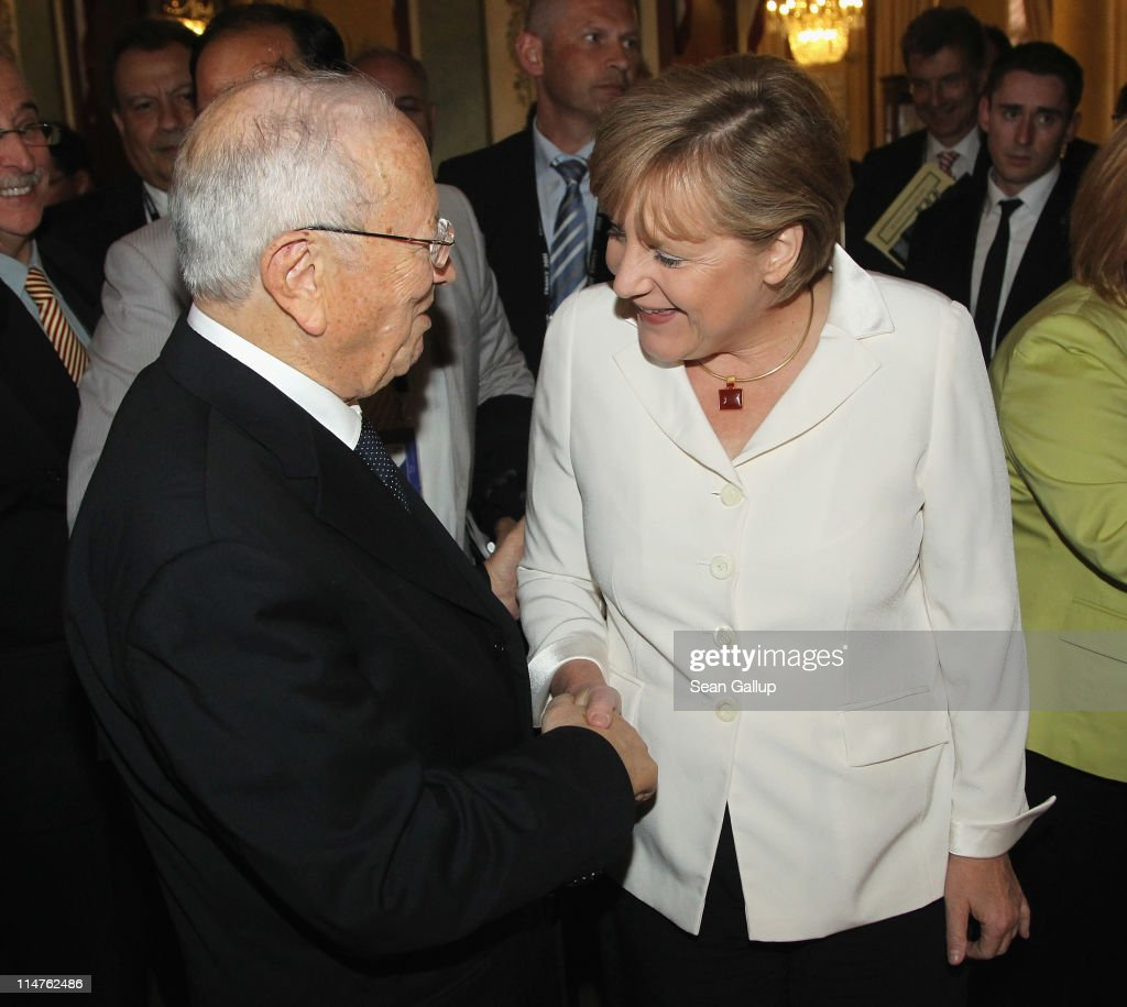 German Chancellor Angela Merkel greets Tunisian Prime Minister <a gi-track='captionPersonalityLinkClicked' href=/galleries/search?phrase=Beji+Caid+Essebsi&family=editorial&specificpeople=998512 ng-click='$event.stopPropagation()'>Beji Caid Essebsi</a> during a bilateral meeting at the G8 Summit on May 26, 2011 in Deauville, France. France is hosting the G8 Summit, which focuses on issues including African development, the Arab Spring and the Internet.