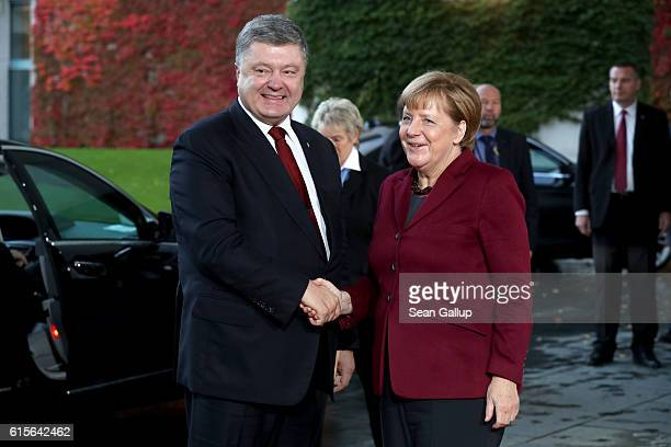 German Chancellor Angela Merkel greets Ukrainian President Petro Poroshenko upon his arrival to discuss the Ukrainian peace process at the...