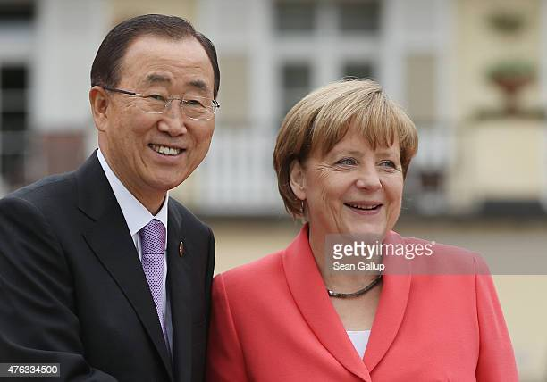 German Chancellor Angela Merkel greets United Nations Secretary General Ban KiMoon on the second day of the summit of G7 nations at Schloss Elmau on...