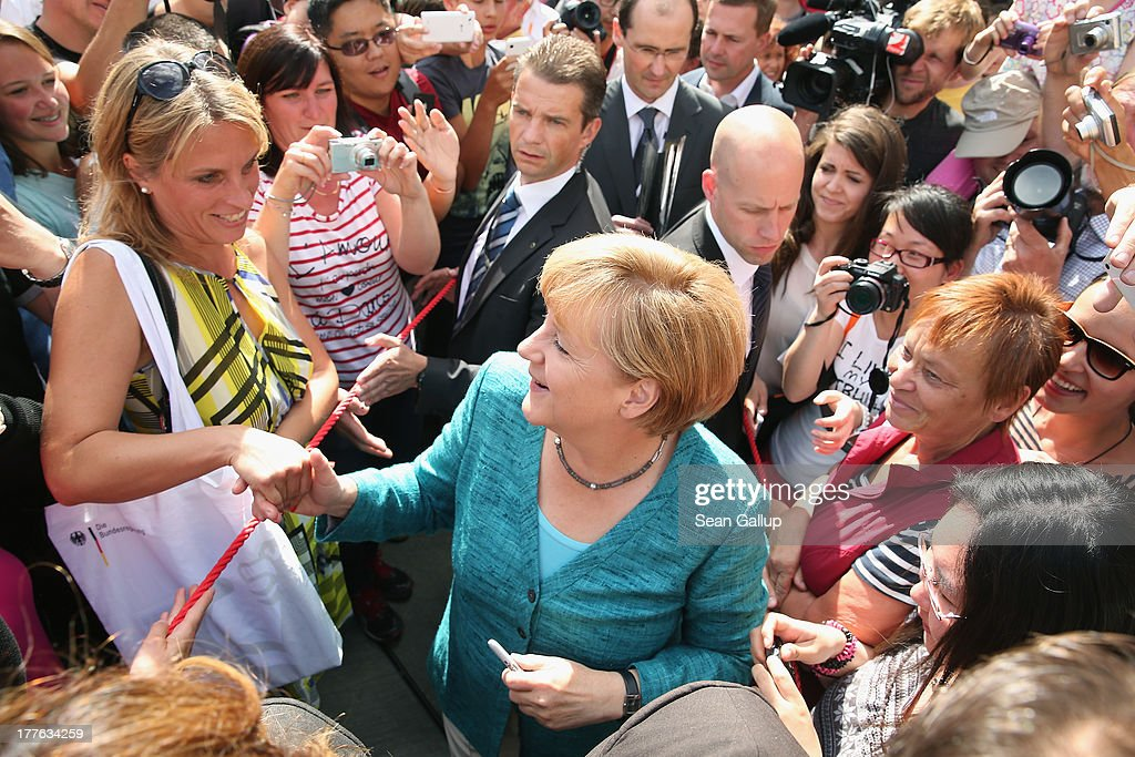 German Chancellor Angela Merkel greets visitors during the annual open-house day at the Chancellery on August 25, 2013 in Berlin, Germany. Germany is facing federal elections scheduled for September 22 and so far the CDU has a substantial lead in polls over the opposition.