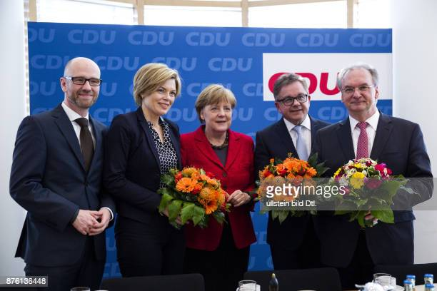 German Chancellor Angela Merkel hands over flowers to the top candidates of the state elections Julia Kloeckner Guido Wolf and Reiner Haseloff in the...
