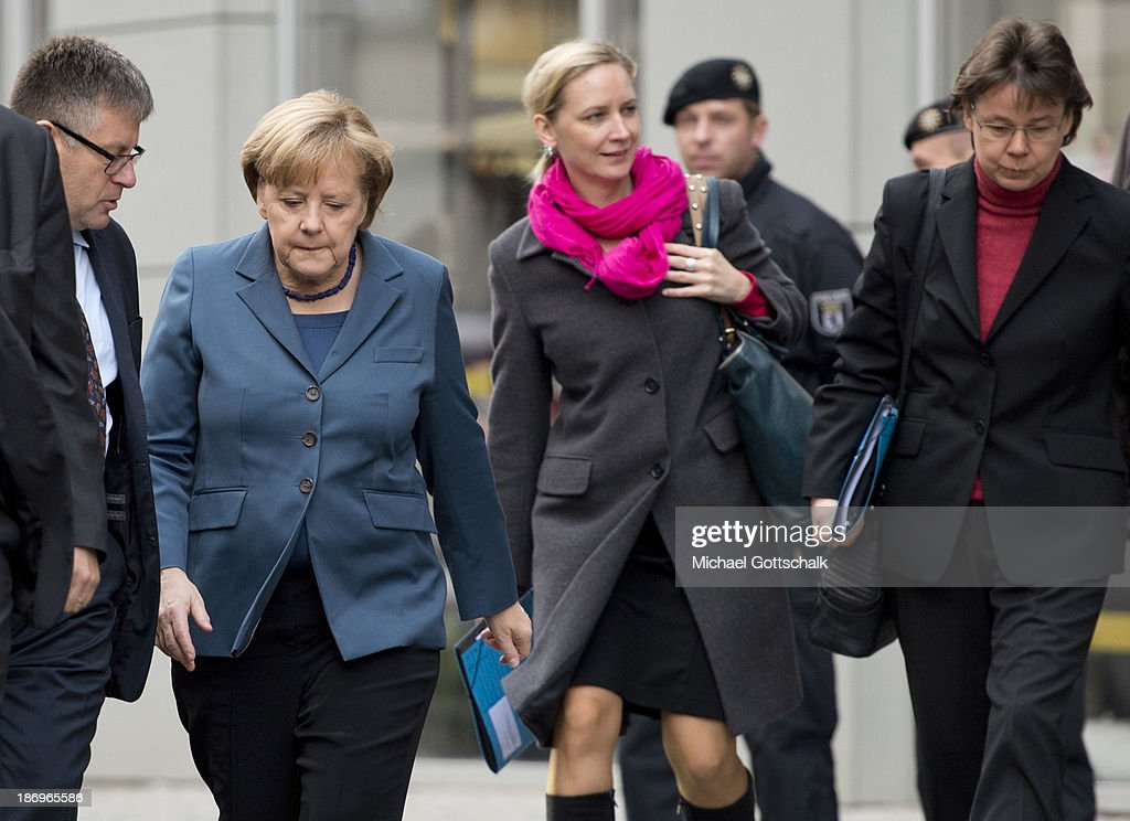 German Chancellor <a gi-track='captionPersonalityLinkClicked' href=/galleries/search?phrase=Angela+Merkel&family=editorial&specificpeople=202161 ng-click='$event.stopPropagation()'>Angela Merkel</a>, her media councellor Eva Christiansen (C) and her head of office, Beate Baumann (R) arrive for negotiations between the German Social Democrats (SPD), German Christian Democrats (CDU) and German Christian Social Democrats at the Bavarian state representation on November 5, 2013 in Berlin, Germany. The SPD, CSU and CDU are hashing through policy issues in an effort to create a new German colaition government following elections in September.