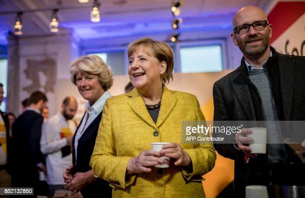 German Chancellor Angela Merkel her party's secretary general Peter Tauber and the Federal Government's Commissioner for Culture and the Media Monika...