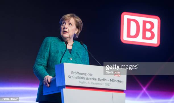 German Chancellor Angela Merkel holds a speech at the main railway station in Berlin during an inauguration of a new fast route between Munich and...