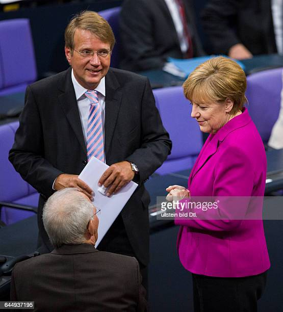 German Chancellor Angela Merkel in the German Bundestag in Berlin on 25 June 2014 To the left of her Roland Pofalla exhead of the chancellery front...