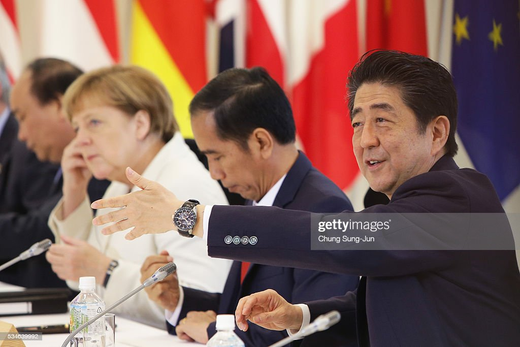 German Chancellor Angela Merkel, Indonesia's President Joko Widodo and Japanese Prime Minister Shinzo Abe attend the 'Outreach Session' on May 27, 2016 in Kashikojima, Japan. In the two-day summit, the G7 leaders discussed the pressing global issues including counter-terrorism, energy policy, and sustainable development.