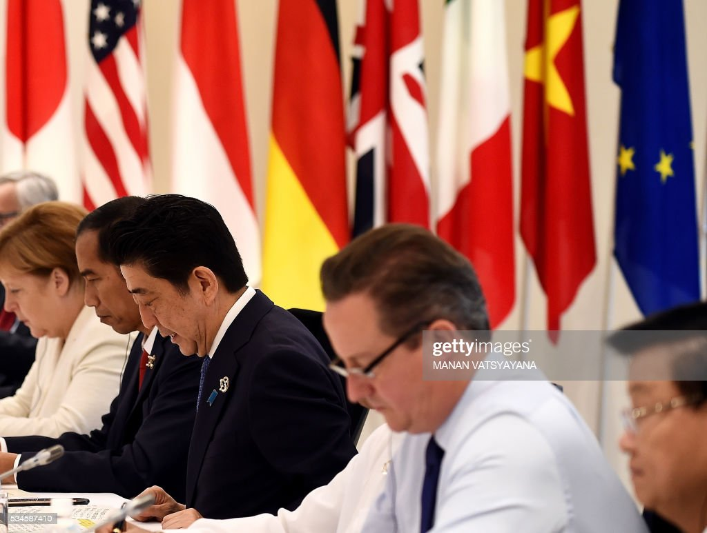German Chancellor Angela Merkel, Indonesia's President Joko Widodo, Japan's Prime Minister Shinzo Abe and Britain's Prime Minister David Cameron attend the Outreach Session of the 2016 Ise-Shima G7 summit in Shima in Mie prefecture on May 27, 2016. Leaders from the Group of Seven advanced democracies met with representatives of emerging and developing countries in Asia and Africa. The so-called outreach programme involves Chad, Indonesia, Sri Lanka, Bangladesh, Papua New Guinea, Vietnam and Laos. / AFP / POOL / Richard BROOKS