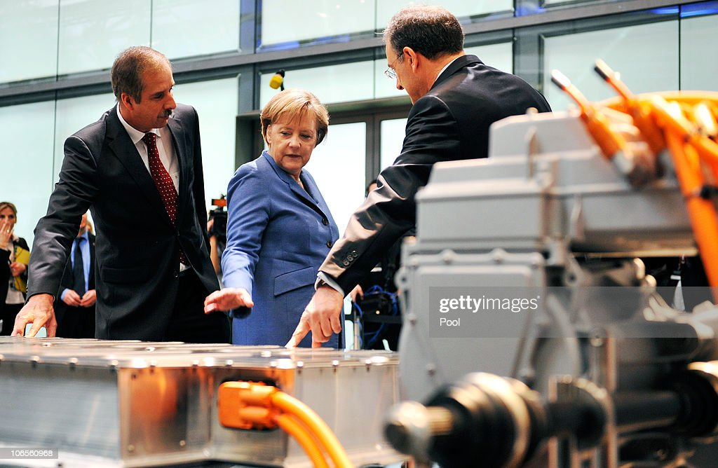 German Chancellor <a gi-track='captionPersonalityLinkClicked' href=/galleries/search?phrase=Angela+Merkel&family=editorial&specificpeople=202161 ng-click='$event.stopPropagation()'>Angela Merkel</a> inspect the drive train of a Megacity Vehicle accompanied by BMW Chairman <a gi-track='captionPersonalityLinkClicked' href=/galleries/search?phrase=Norbert+Reithofer&family=editorial&specificpeople=885003 ng-click='$event.stopPropagation()'>Norbert Reithofer</a> and Klaus Draeger, head od development at BMW, during a visit of the BMW auto assembly plant on November 5, 2010 in Leipzig, Germany. Later Merkel and Reithofer officially inaugurated BMW's committment to invest EUR 400 million to expand production at Leipzig and to mass produce a BMW electric car.