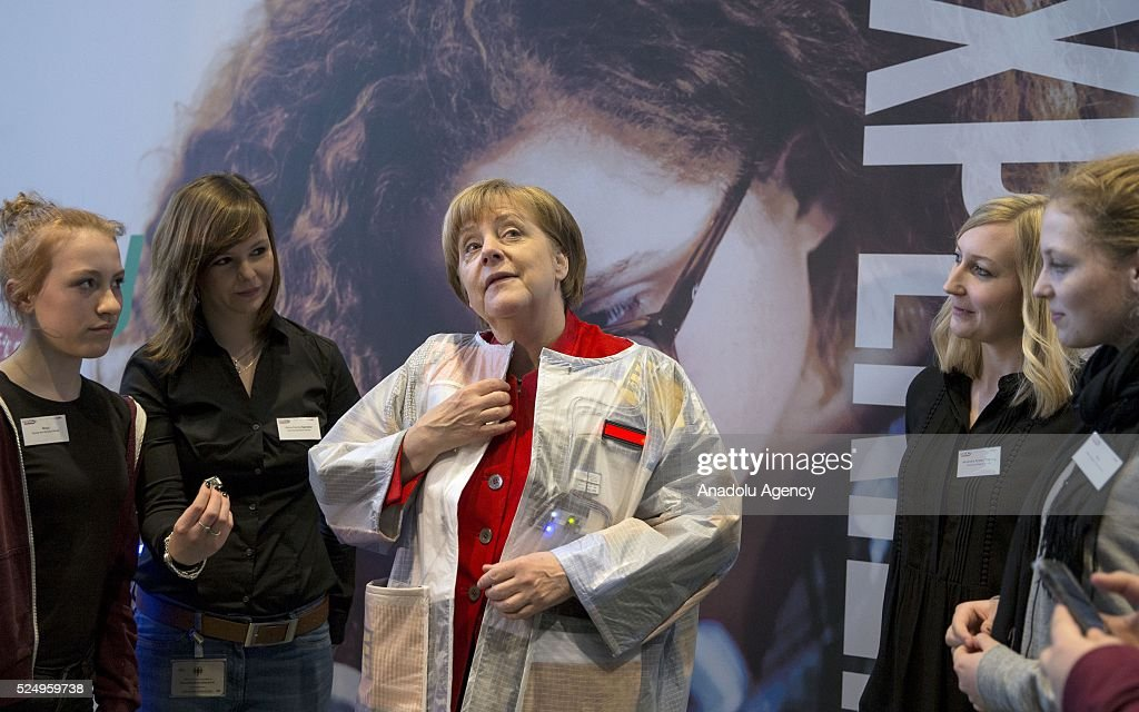chancellor girls German chancellor angela merkel reacts to a robot as she visits a stand of the frauenhofer institut during the annual girls' day at the chancellery in berlin, germany.