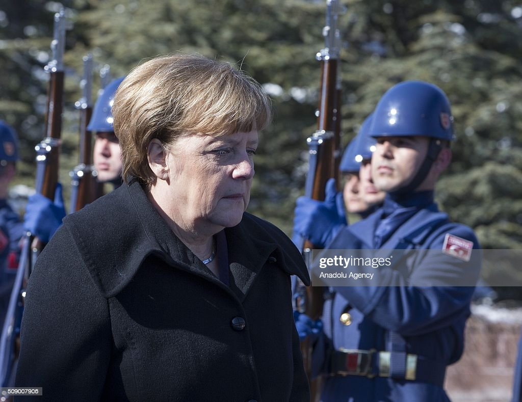 German Chancellor Angela Merkel (R) inspects the honor guards during the official welcoming ceremony in Ankara, Turkey on February 8, 2016.