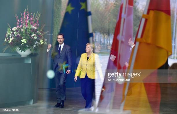 TOPSHOT German Chancellor Angela Merkel is accompanied by her spokesman Steffen Seibert as she prepares to welcome her guest Georgia's Prime Minister...