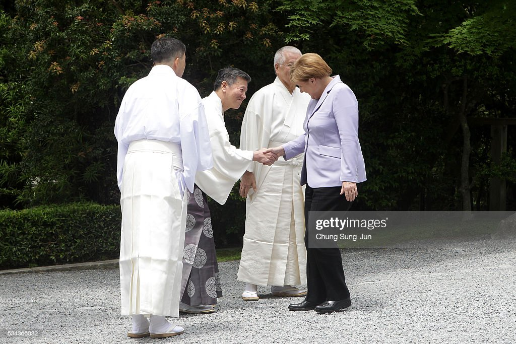 German Chancellor <a gi-track='captionPersonalityLinkClicked' href=/galleries/search?phrase=Angela+Merkel&family=editorial&specificpeople=202161 ng-click='$event.stopPropagation()'>Angela Merkel</a> is greet by Shinto priests as he visit the Ise-Jingu Shrine on May 26, 2016 in Ise, Japan. In the two-day summit, the G7 leaders are scheduled to discuss the pressing global issues including counter-terrorism, energy policy, and sustainable development.