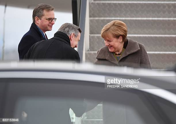 German Chancellor Angela Merkel is greeted by Mikael Damberg Sweden's Minister for Enterprise and Innovation and Germany's ambassdor to Sweden...