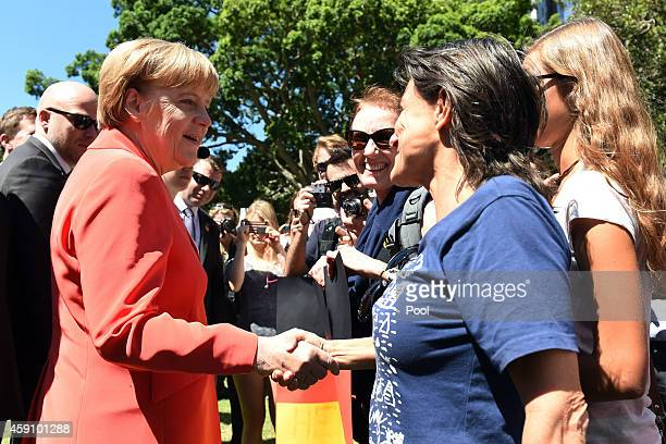 German Chancellor Angela Merkel is greeted by wellwishers following her visit to the ANZAC Memorial in Hyde Park on November 17 2014 in Sydney...