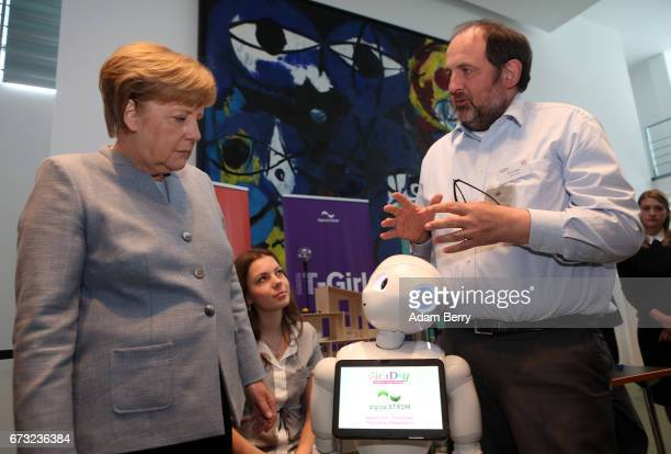 German Chancellor Angela Merkel is introduced to Pepper the Robot by DigitalSTROM employee Martin Vesper on Girls' Day on April 26 2017 in Berlin...