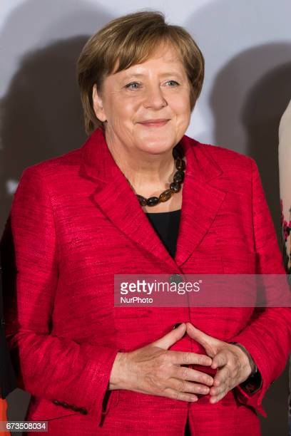 German Chancellor Angela Merkel is pictured as she poses for a family picture during the Woman 20 Summit in Berlin Germany on April 25 2017 The event...