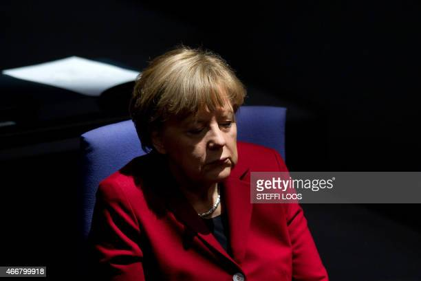 German Chancellor Angela Merkel is pictured at the parliament after her speech on the next EU summit at the German Bundestag on March 19 2015 in...